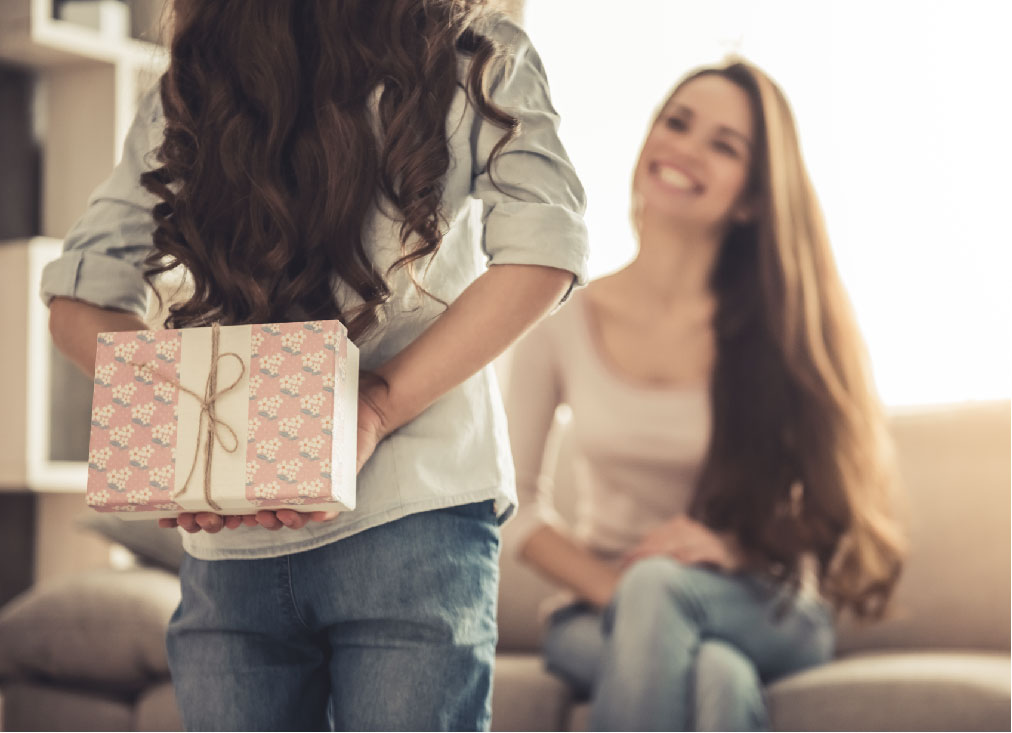 Woman giving other woman gift