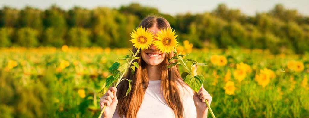 Woman with sunflowers over eyes
