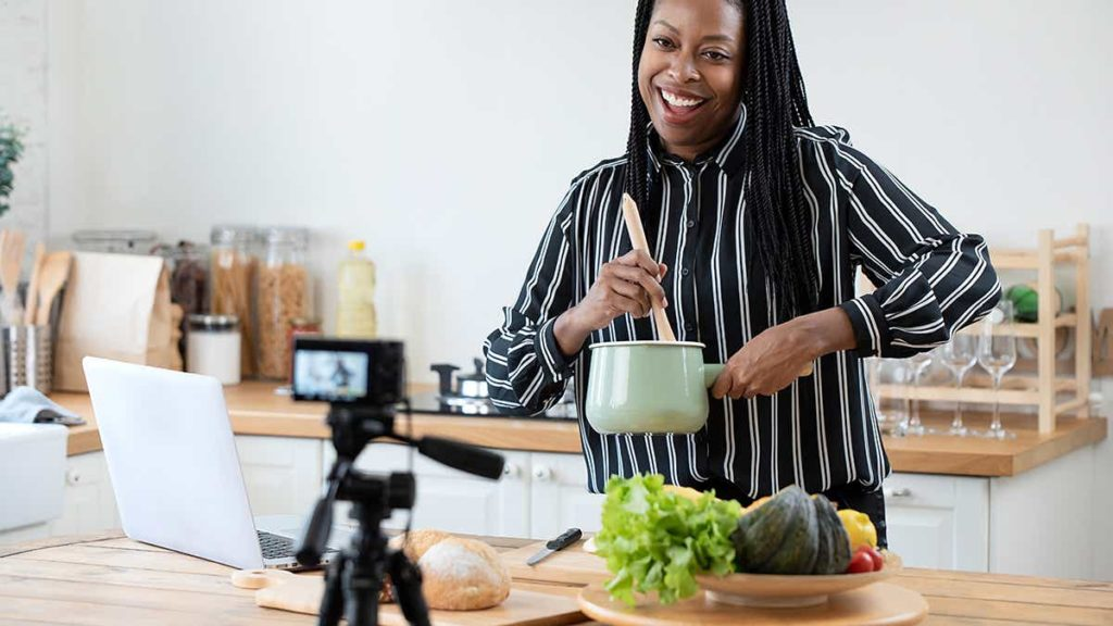 Woman cooking in front of camera