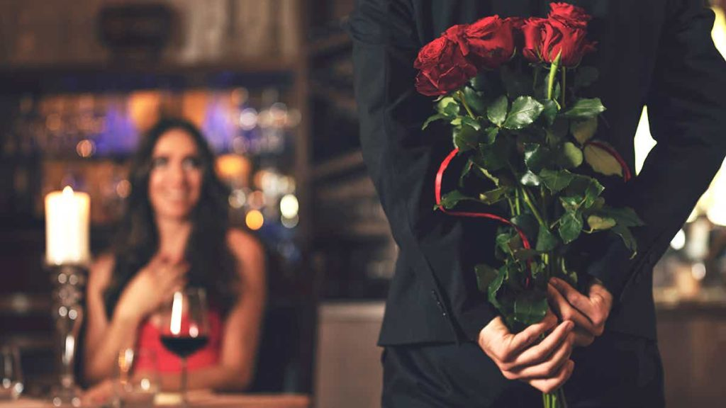 Man surprising woman with roses