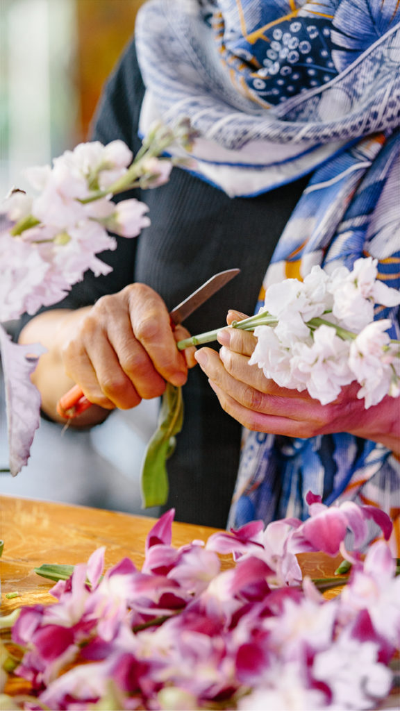 A close-up shot of local florist Vivian Chang arranging flowers at her Los Angeles-area shop