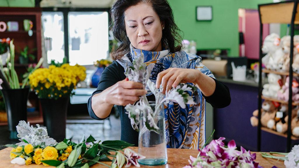 Local florist Vivian Chang arranges flowers at her Los Angeles-area shop