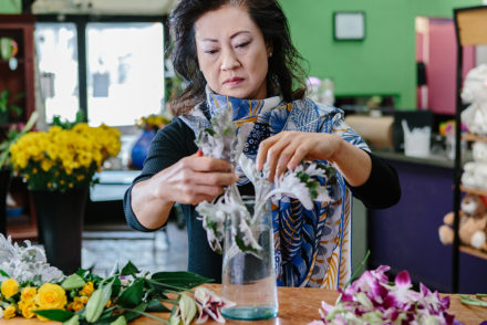 Local florist Vivian Chang arranges flowers at her Los Angeles-area shop