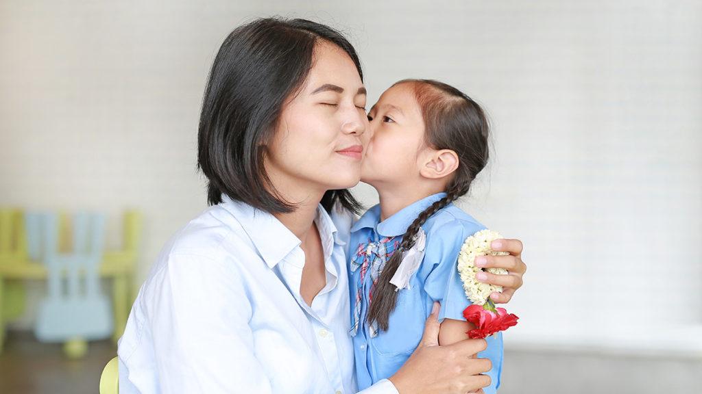 Girl kissing mother