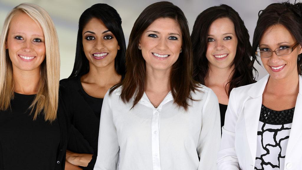 Five businesswomen in an office