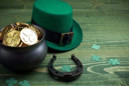 Gold coins and green hat