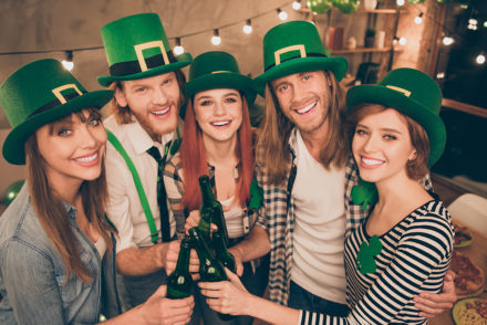 Five friends celebrating St. Patrick's Day