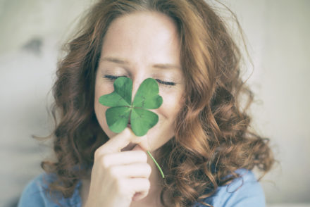 Woman with four-leaf clover