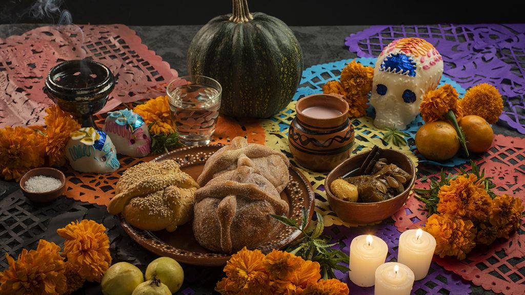 A photo of a table set up for Dia de los Muertos