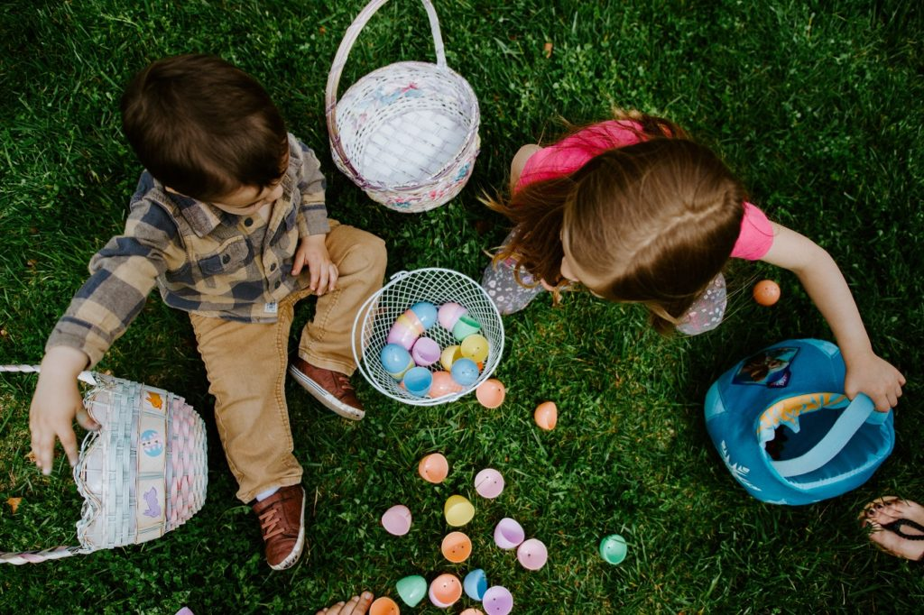 Boy and girl collecting Easter eggs