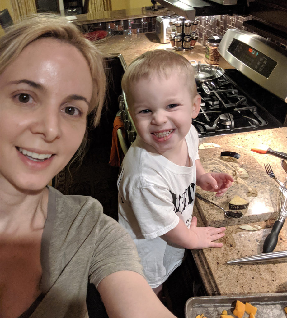 Dr. Chloe cooking with her son
