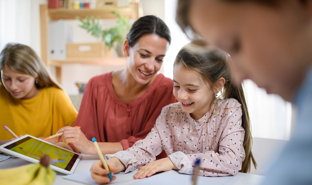 Kids doing homework with parents