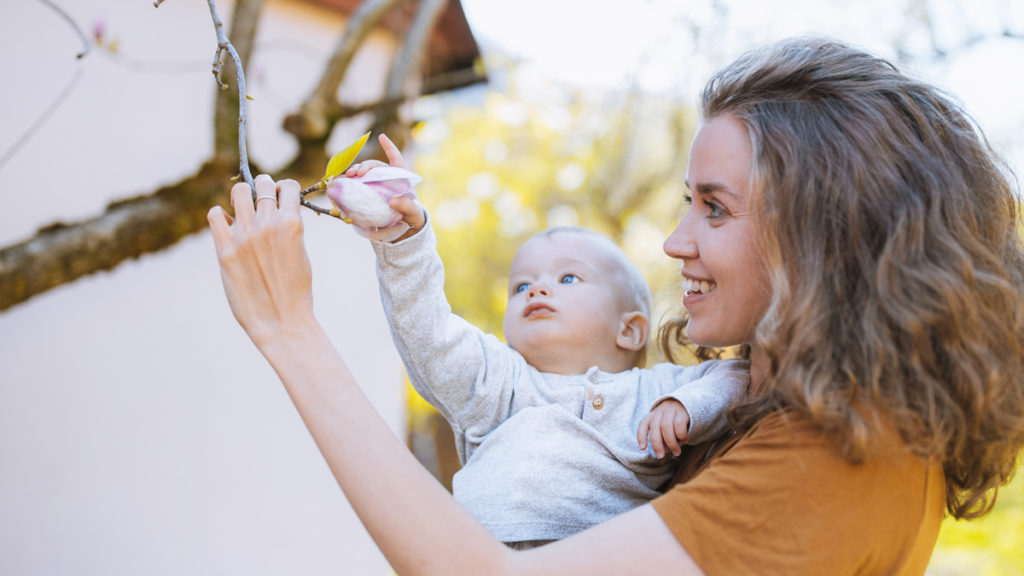 Mommy brain isn't bad -- it's one of the benefits of motherhood and another reason to celebrate moms. In this photo, a mom shows her baby a tree branch.