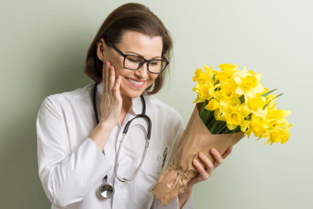 Nurse with yellow flowers