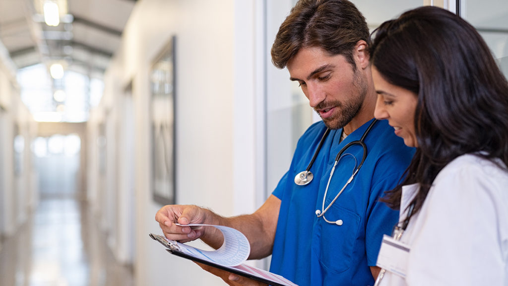 Doctor and nurse looking at chart