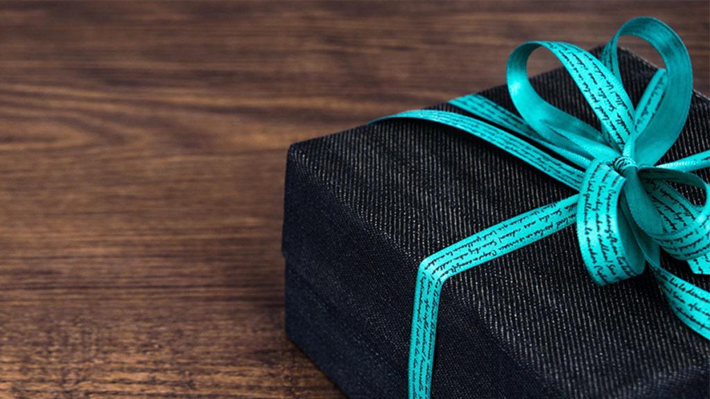Dark blue gift box with blue ribbon