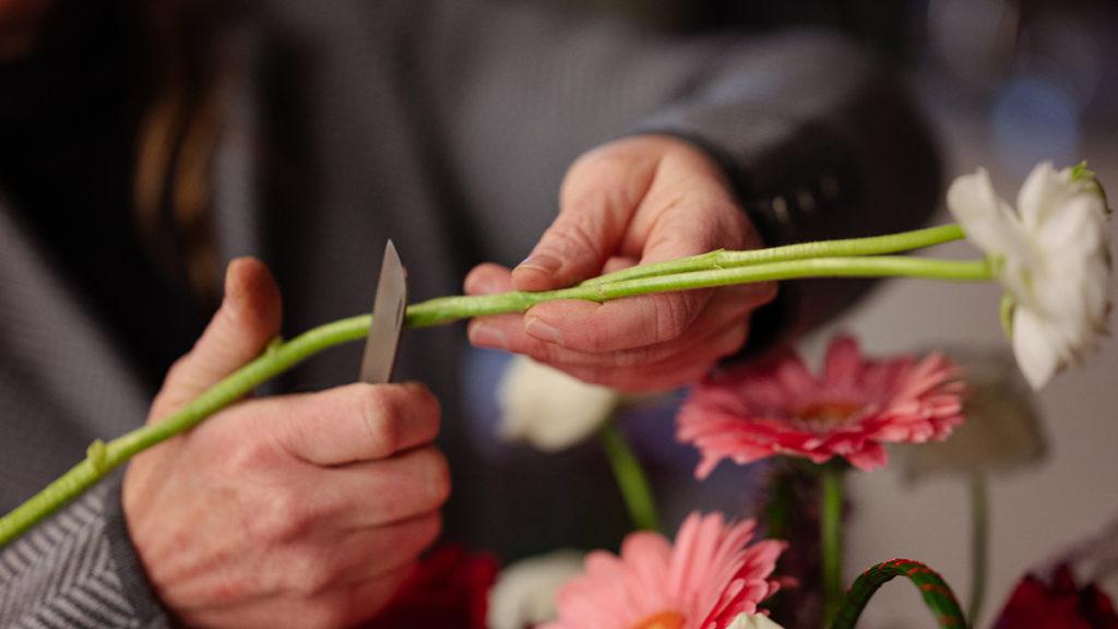 Local florist Patti Fowler trims flower stems