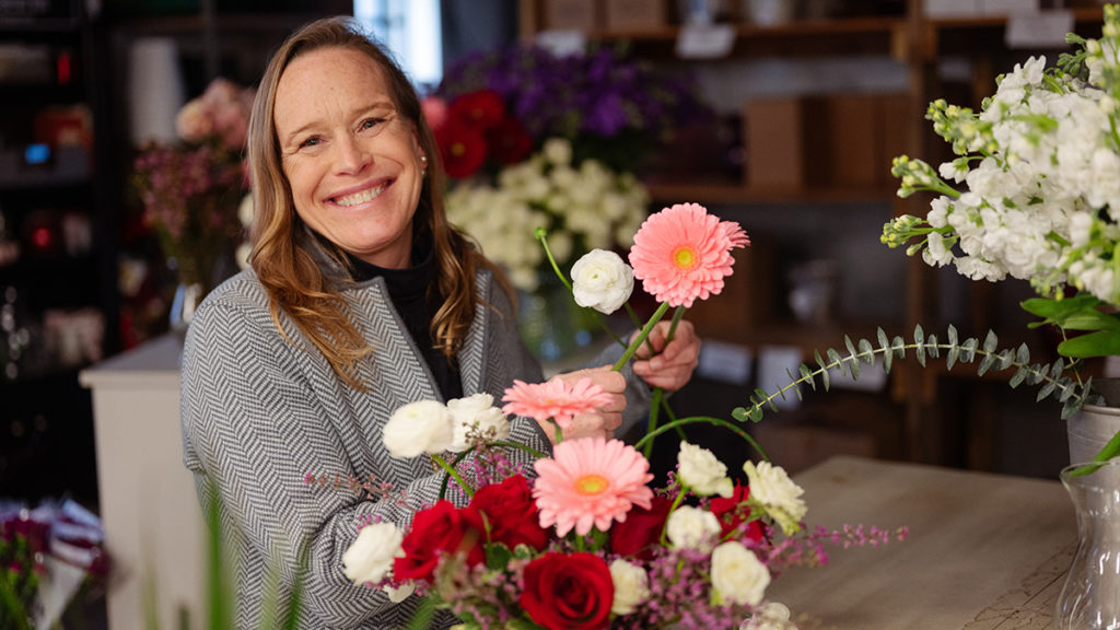Local florist Patti Fowler arranges a collection of flowers