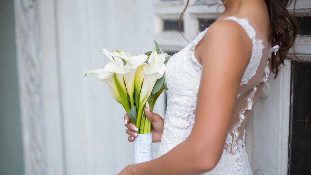 Bride holding calla lily bouquet