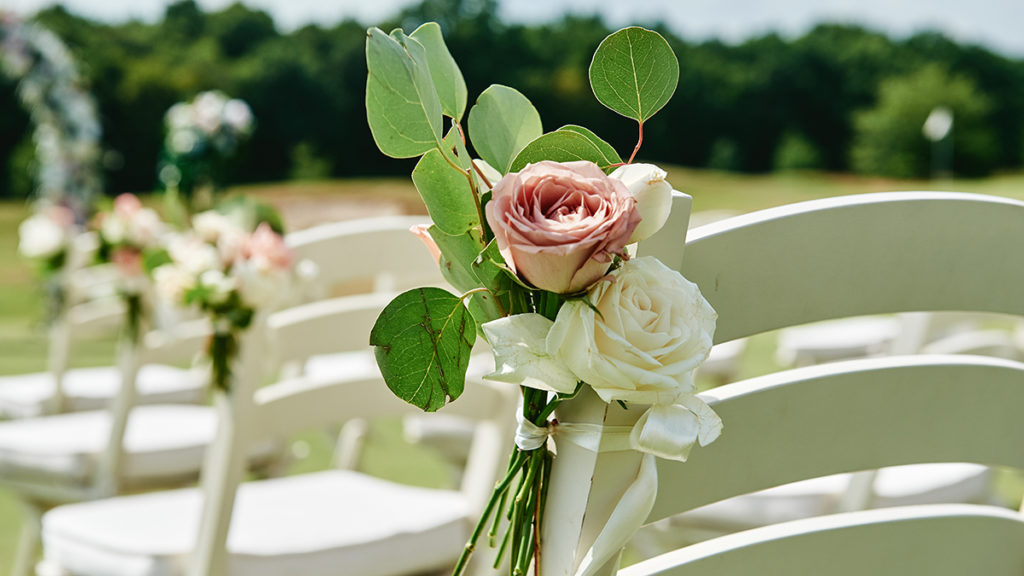 Garden roses on wedding chairs