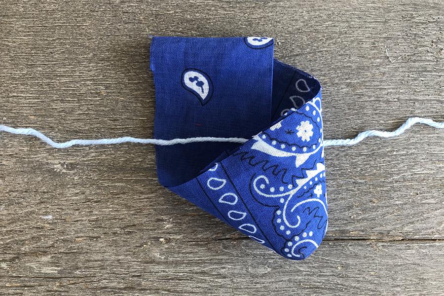 Tying blue bandana