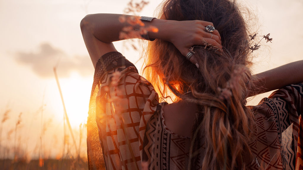 Photo of a young woman at sunset
