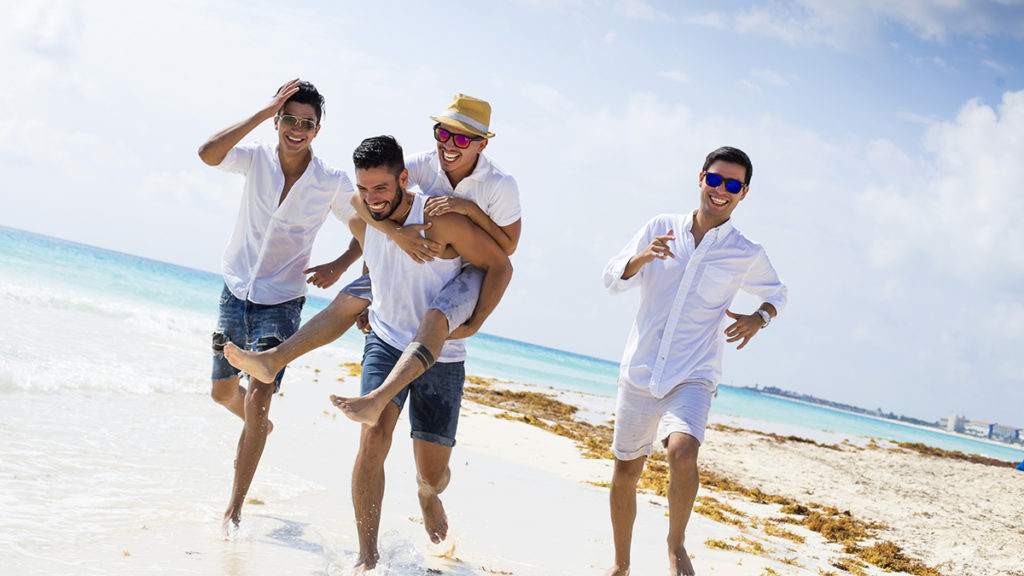 Men running on beach