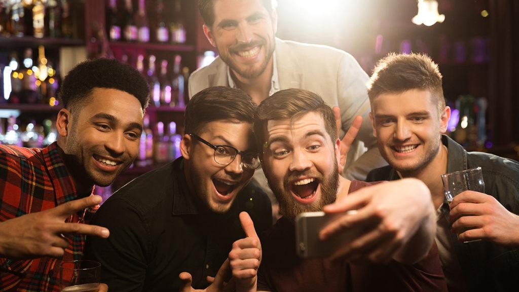 Men taking a selfie