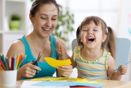 Woman and girl laughing
