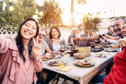 Family eating dinner outside