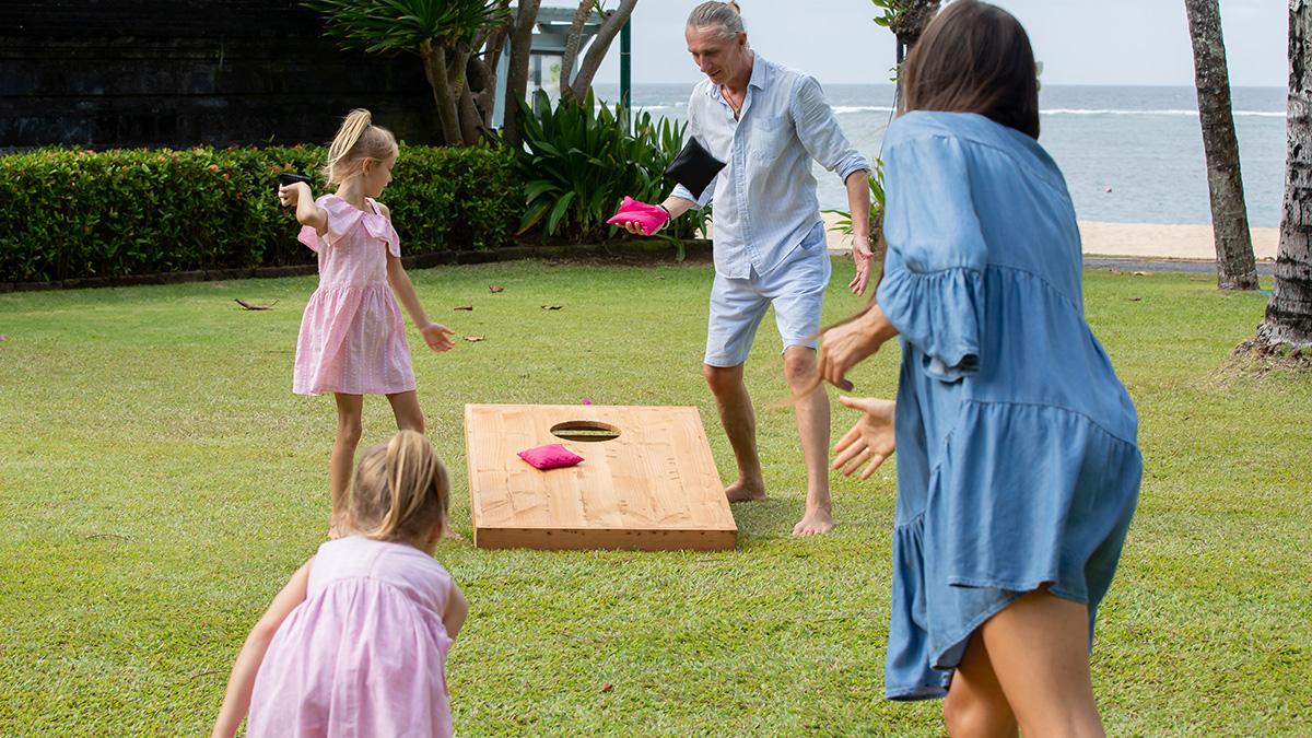 Family playing cornhole