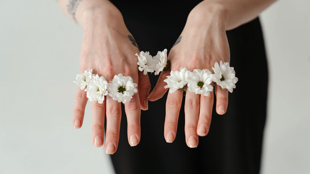 white flowers on hand as rings