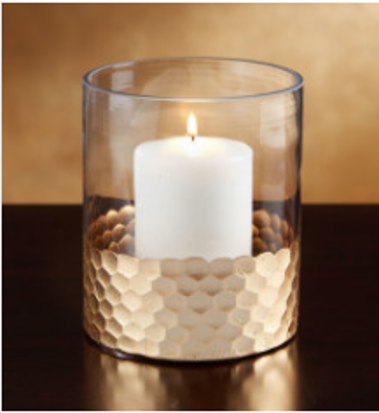 A glass vase reused as a candle holder