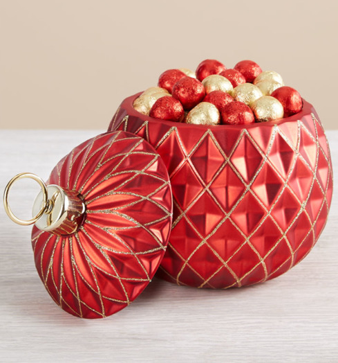 Photo of a red flower vase that can hold potpourri and other items