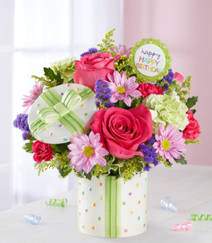 Photo of a flower vase repurposed as a holder of birthday mementos.