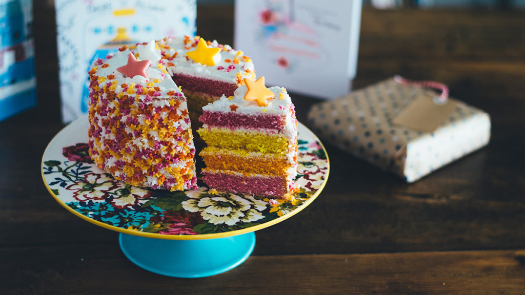 Photo of a birthday cake that shows fall colors popular for people celebrating September birthdays