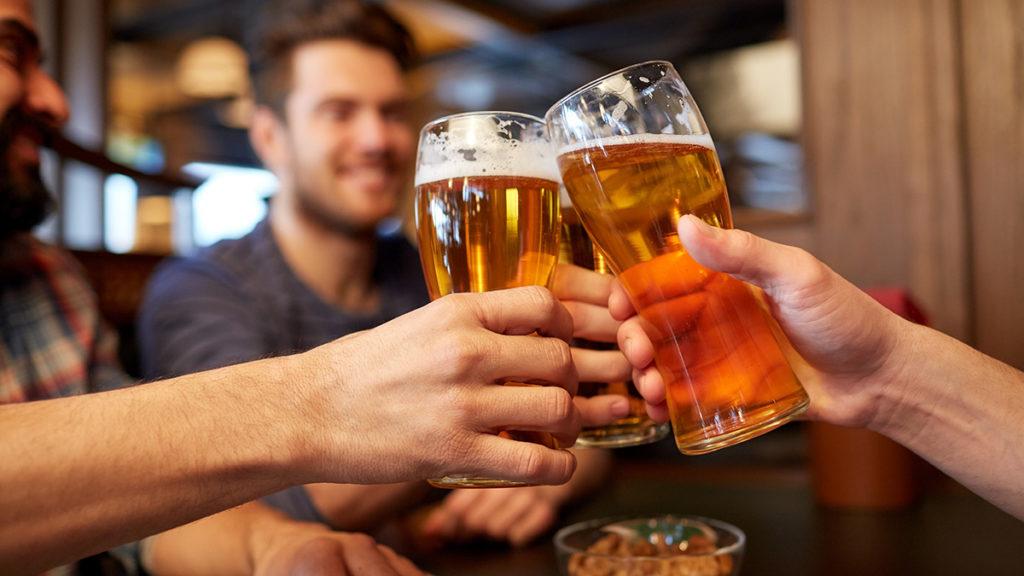 Photo of men enjoying beer while celebrating their September birthdays.