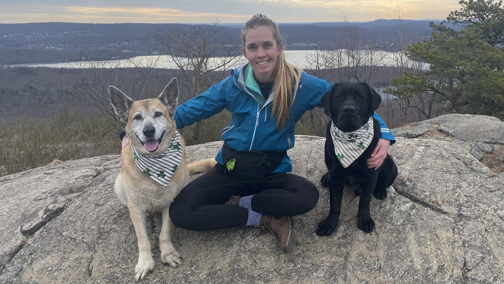 Photo of Heather Myers, an expert on pet sympathy messages, with her dogs Hope and Sailor.