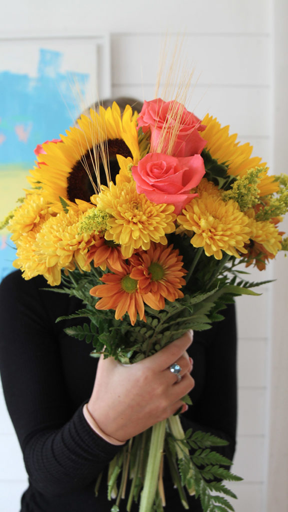 People who love fall often enjoy bouquets of sunflowers and mums like those pictured here.