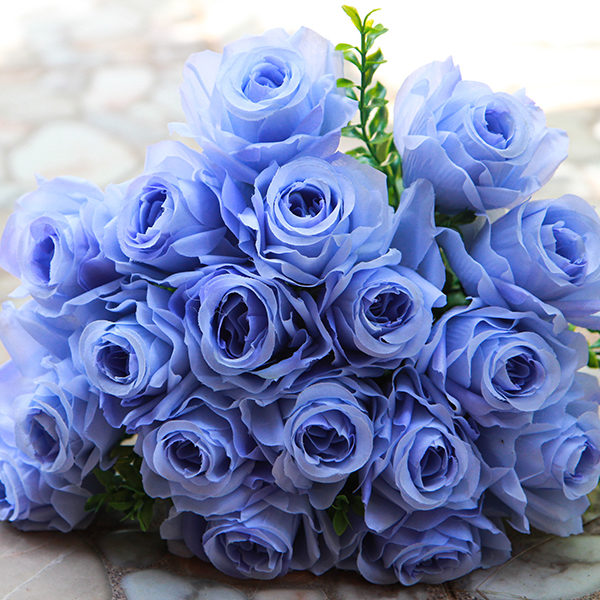 Blue roses are incredibly rare because they're engineered rather than grown naturally. For this reason, gifting someone blue roses tells them that they're unique, one-of-a-kind, and truly special.