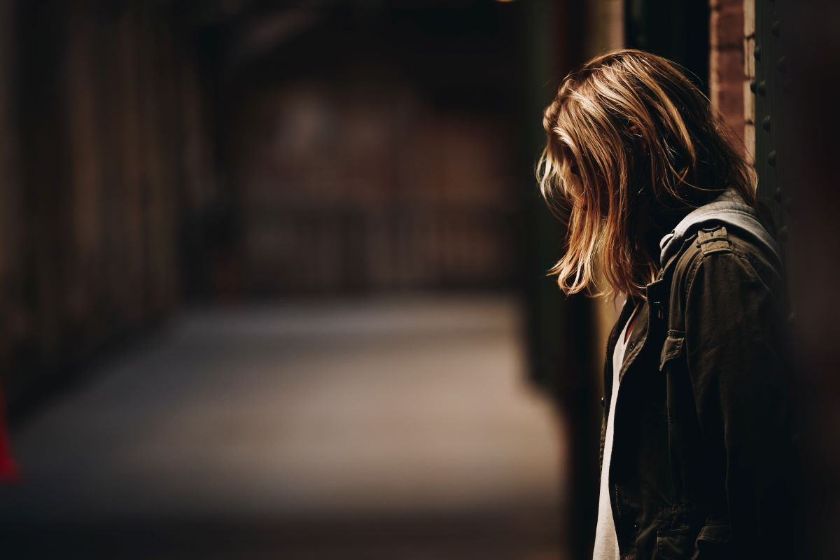 Photo of a woman navigating the long arc of grief after a recent loss.