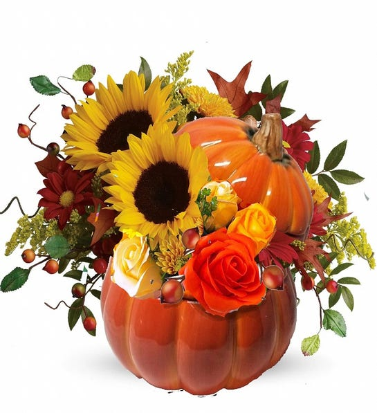 Photo of a ceramic pumpkin flower arrangement, a great way to boost the Halloween decor of your living room's coffee table.