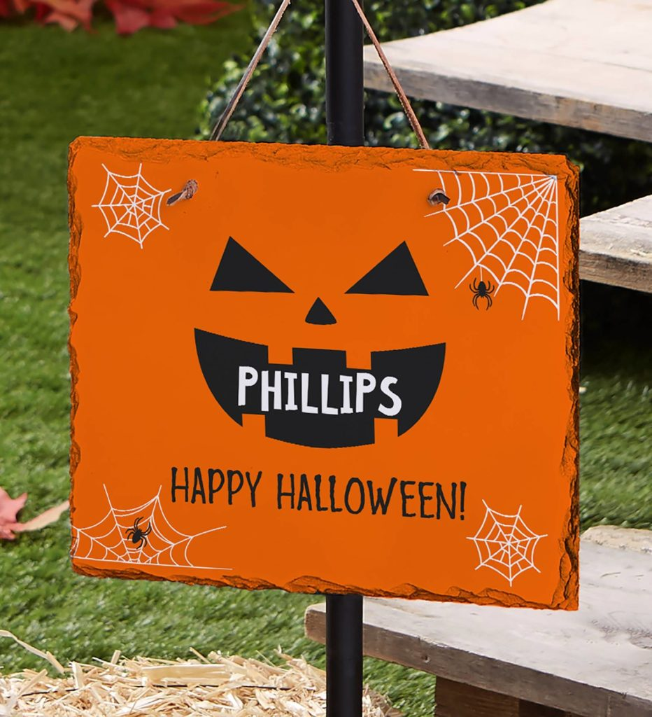 Photo of a personalized lawn sign that greets trick-or-treaters.